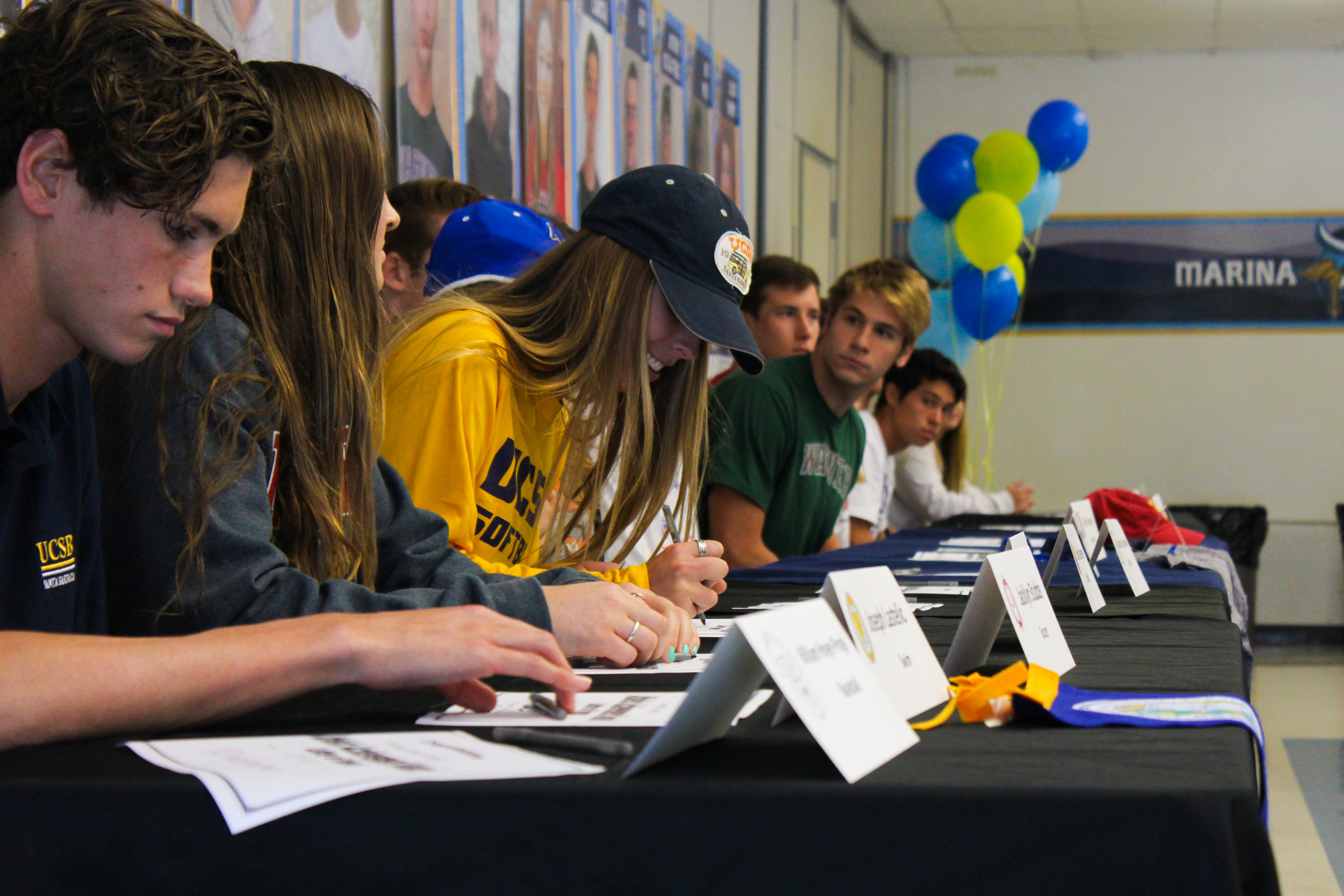 Student athletics signing letters of intent for college